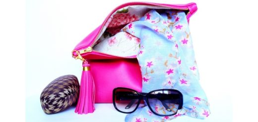 Hot pink fold-over clutch bag from Qmuro