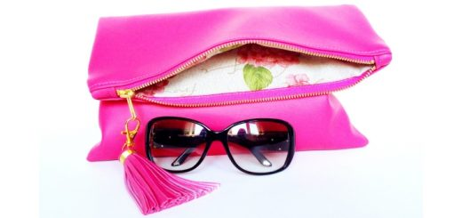 Win this hot pink fold-over clutch bag from Qmuro